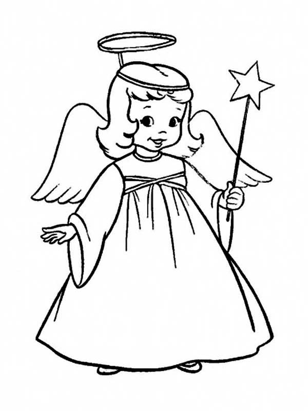 a charming little girl in angel costume on christmas