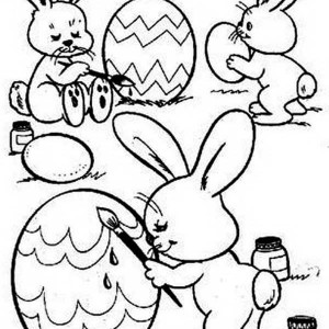 Three Cute Bunnies Decorating An Easter Eggs Coloring Page